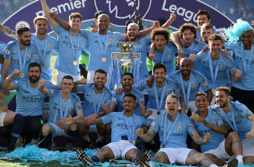 BRIGHTON, ENGLAND - MAY 12: Manchester City players celebrate with the Premier League Trophy after winning the title during the Premier League match between Brighton & Hove Albion and Manchester City at American Express Community Stadium on May 12, 2019 in Brighton, United Kingdom. (Photo by Mike Hewitt/Getty Images)