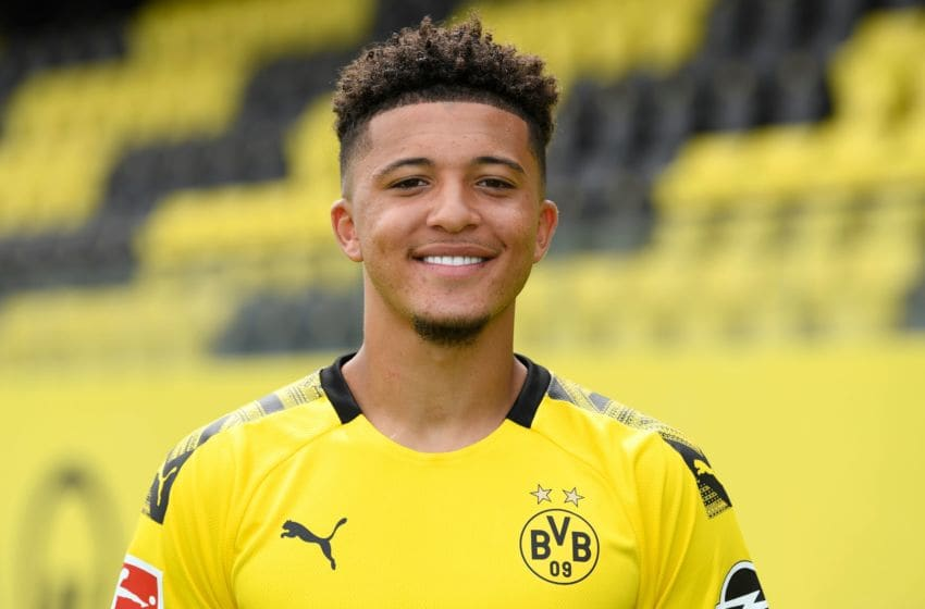 Dortmund's English forward Jadon Sancho poses for a photo during the presentation of Borussia Dortmund's squad for the upcoming first Bundesliga season at their training ground in Dortmund, western Germany, on August 6, 2019. (Photo by INA FASSBENDER / POOL / AFP) (Photo credit should read INA FASSBENDER/AFP via Getty Images)