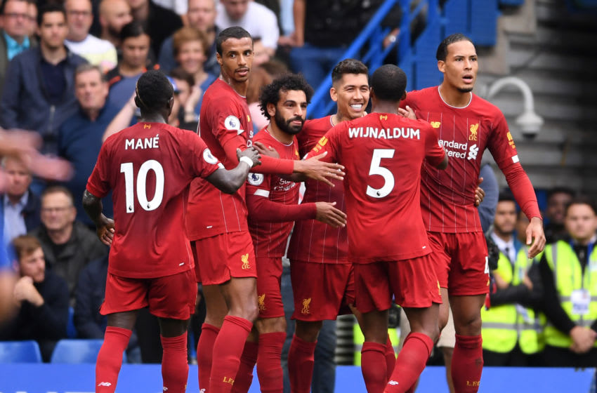 LONDON, ENGLAND - SEPTEMBER 22: Roberto Firmino of Liverpool celebrates with teammates after scoring his team's second goal during the Premier League match between Chelsea FC and Liverpool FC at Stamford Bridge on September 22, 2019 in London, United Kingdom. (Photo by Laurence Griffiths/Getty Images)