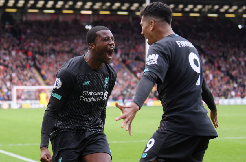 SHEFFIELD, ENGLAND - SEPTEMBER 28: Georginio Wijnaldum of Liverpool celebrates with teammate Roberto Firmino after scoring his team's first goal during the Premier League match between Sheffield United and Liverpool FC at Bramall Lane on September 28, 2019 in Sheffield, United Kingdom. (Photo by Laurence Griffiths/Getty Images)