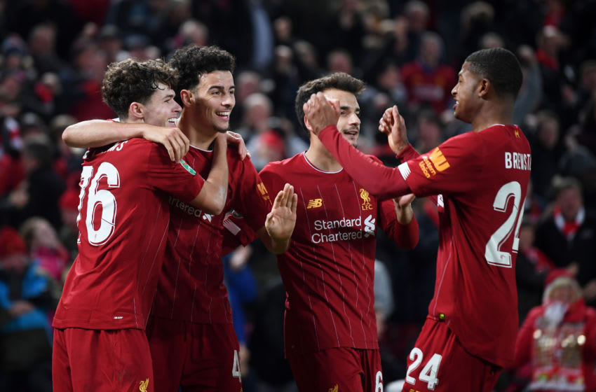 LIVERPOOL, ENGLAND - OCTOBER 30: Neco Williams of Liverpool is congratulated by Curtis Jones and Rhian Brewster after assisting Liverpool's fifth goal of the game by during the Carabao Cup Round of 16 match between Liverpool and Arsenal at Anfield on October 30, 2019 in Liverpool, England. (Photo by Laurence Griffiths/Getty Images)
