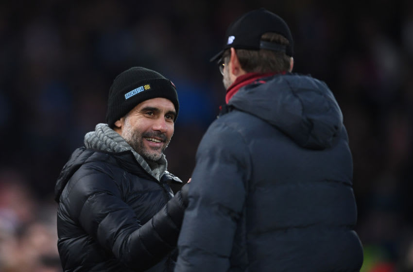 LIVERPOOL, ENGLAND - NOVEMBER 10: Josep Guardiola of Manchester City is greeted by Jurgen Klopp of Liverpool looks on with ta smile ahead of the Premier League match between Liverpool FC and Manchester City at Anfield on November 10, 2019 in Liverpool, United Kingdom. (Photo by Laurence Griffiths/Getty Images)