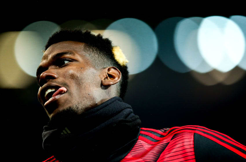 MANCHESTER, ENGLAND - DECEMBER 26: Paul Pogba of Manchester United warms up during the Premier League match between Manchester United and Newcastle United at Old Trafford on December 26, 2019 in Manchester, United Kingdom. (Photo by Robbie Jay Barratt - AMA/Getty Images)
