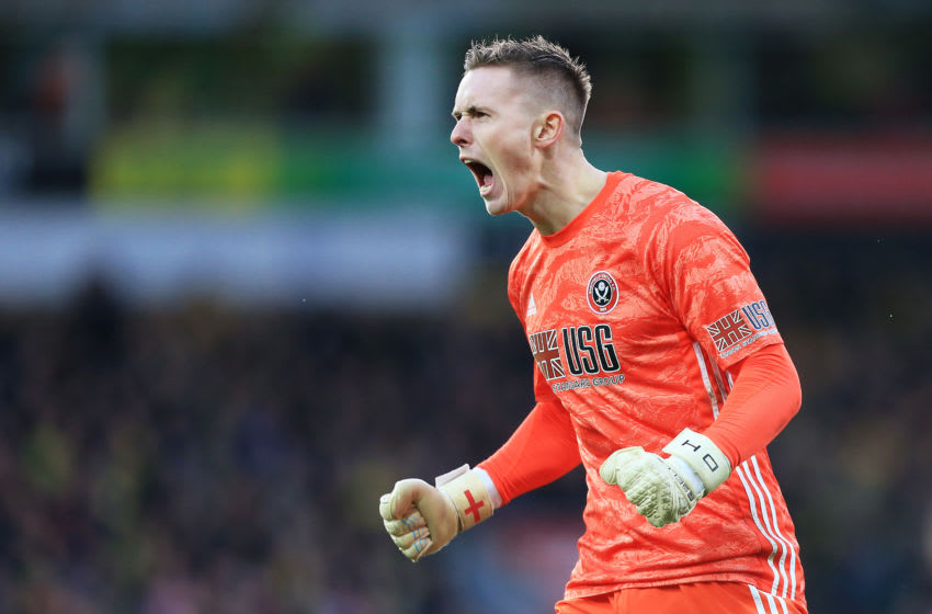NORWICH, ENGLAND - DECEMBER 08: Dean Henderson of Sheffield United celebrates his team's first goal during the Premier League match between Norwich City and Sheffield United at Carrow Road on December 08, 2019 in Norwich, United Kingdom. (Photo by Stephen Pond/Getty Images)