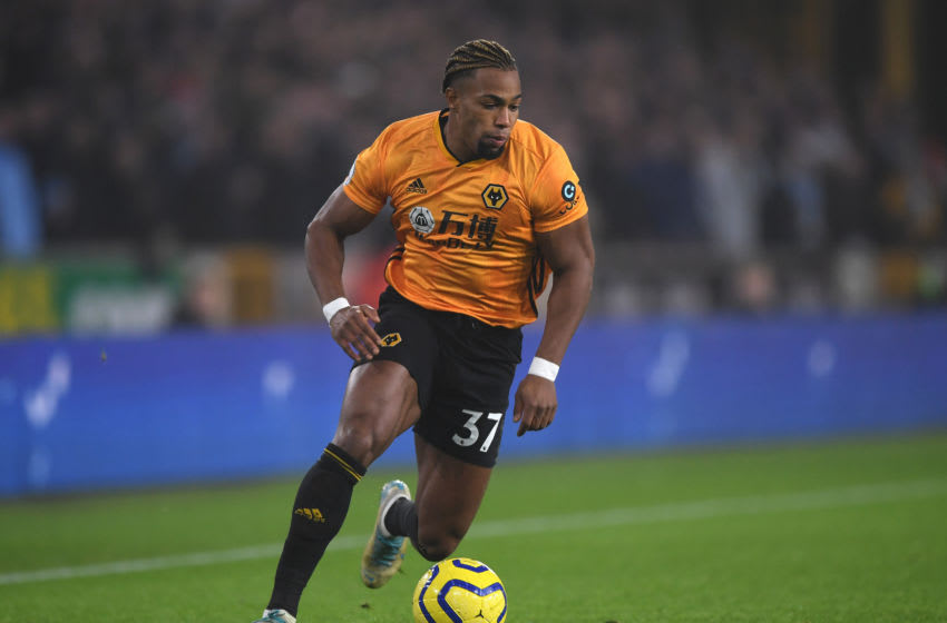 WOLVERHAMPTON, ENGLAND - DECEMBER 27: Adama Traore of Wolverhampton Wanderers runs with the ball during the Premier League match between Wolverhampton Wanderers and Manchester City at Molineux on December 27, 2019 in Wolverhampton, United Kingdom. (Photo by Shaun Botterill/Getty Images)
