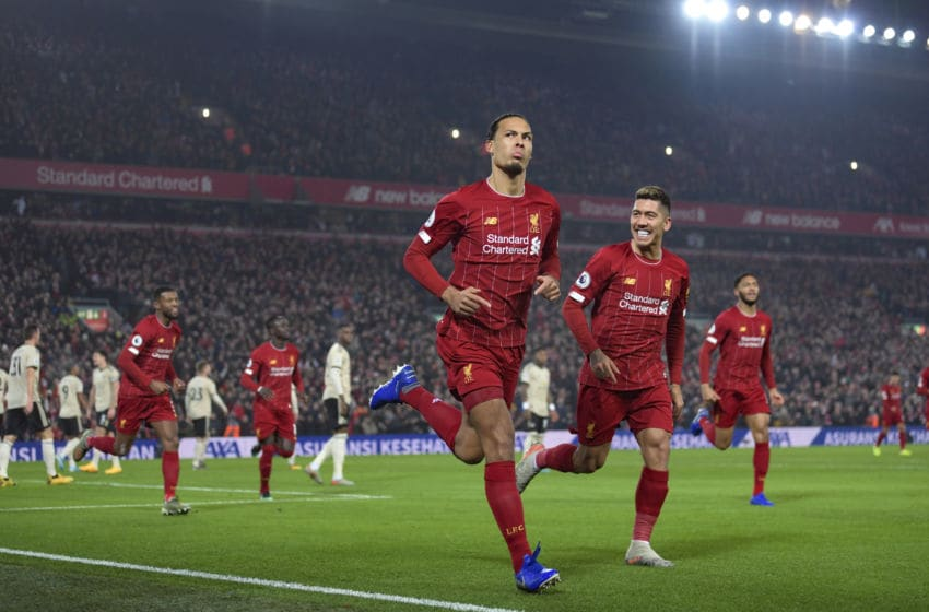 LIVERPOOL, ENGLAND - JANUARY 19: Virgil van Dijk of Liverpool celebrates scoring to make it 1-0 during the Premier League match between Liverpool FC and Manchester United at Anfield on January 19, 2020 in Liverpool, United Kingdom. (Photo by Michael Regan/Getty Images)