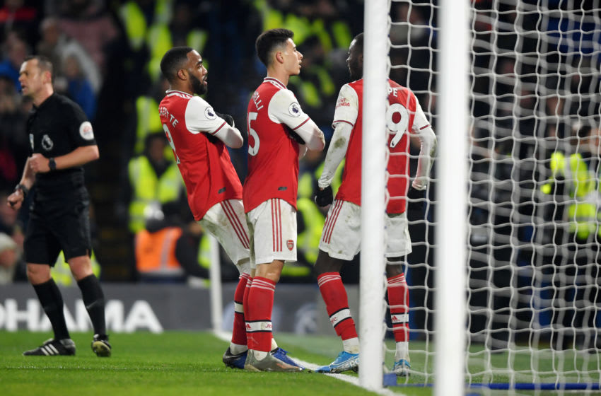 LONDON, ENGLAND - JANUARY 21: Gabriel Martinelli of Arsenal celebrates with his team mates after scoring his team's first goal during the Premier League match between Chelsea FC and Arsenal FC at Stamford Bridge on January 21, 2020 in London, United Kingdom. (Photo by Mike Hewitt/Getty Images)