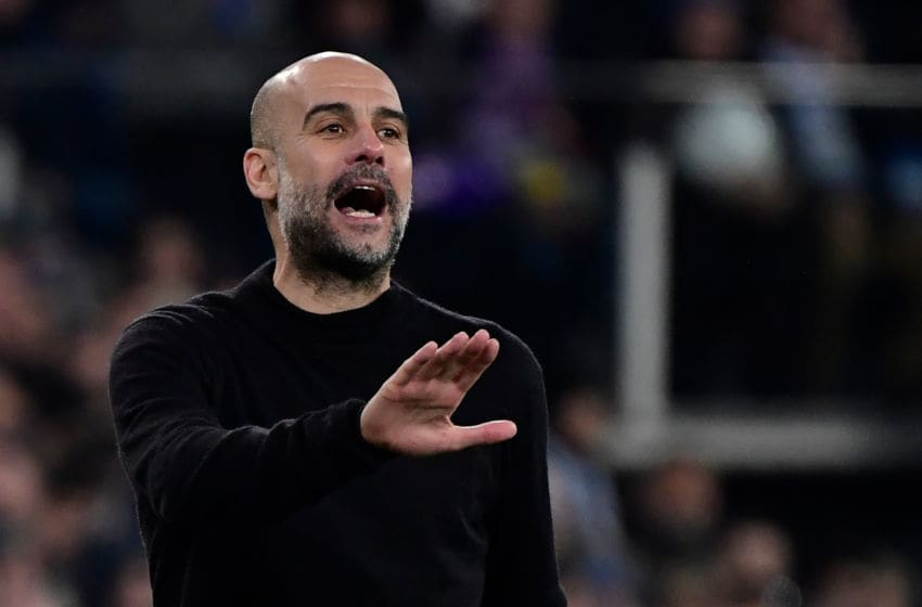 Manchester City's Spanish manager Pep Guardiola gestures during the UEFA Champions League round of 16 first-leg football match between Real Madrid CF and Manchester City at the Santiago Bernabeu stadium in Madrid on February 26, 2020. (Photo by JAVIER SORIANO / AFP) (Photo by JAVIER SORIANO/AFP via Getty Images)