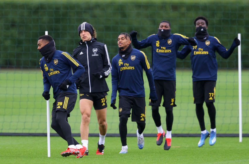 ST ALBANS, ENGLAND - FEBRUARY 19: (L-R) Joseph Willock, David Luiz, Reiss Nelson, Ainsley Maitland-Niles and Bukayo Saka of Arsenal warm up during a Arsenal Training Session at London Colney on February 19, 2020 in St Albans, England. (Photo by Richard Heathcote/Getty Images)