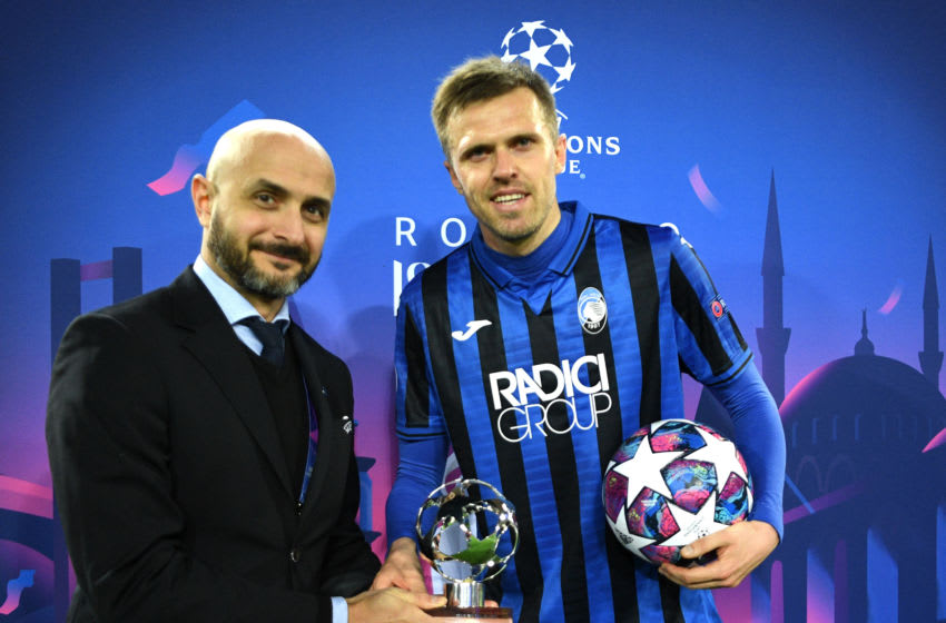 VALENCIA, SPAIN - MARCH 10: (FREE FOR EDITORIAL USE) In this handout image provided by UEFA, Josip Ilicic of Atalanta recieves the man of the match award and also the match ball after he scores all 4 goals of the match for his team during the UEFA Champions League round of 16 second leg match between Valencia CF and Atalanta at Estadio Mestalla on March 10, 2020 in Valencia, Spain. (Photo by UEFA - Handout via Getty Images)