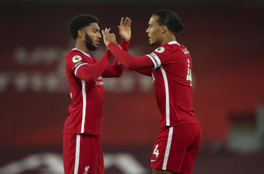 Joe Gomez and Virgil Van Dijk of Liverpool (Photo by Robbie Jay Barratt - AMA/Getty Images)