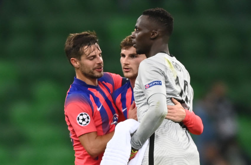 Chelsea's German forward Timo Werner and goalkeeper Edouard Mendy, Champions League (Photo by KIRILL KUDRYAVTSEV/AFP via Getty Images)