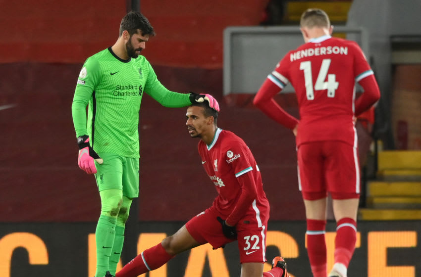 Liverpool's Alisson Becker and Joel Matip (Photo by STU FORSTER/POOL/AFP via Getty Images)