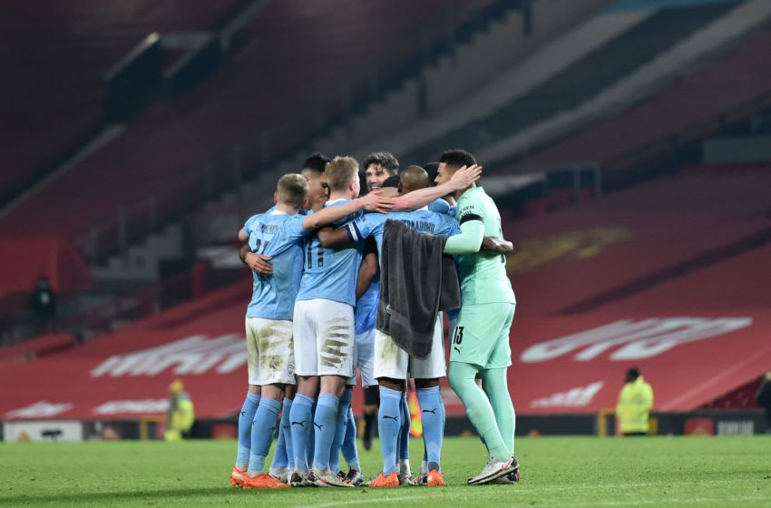 Manchester City's players celebrate (Photo by PETER POWELL/POOL/AFP via Getty Images)