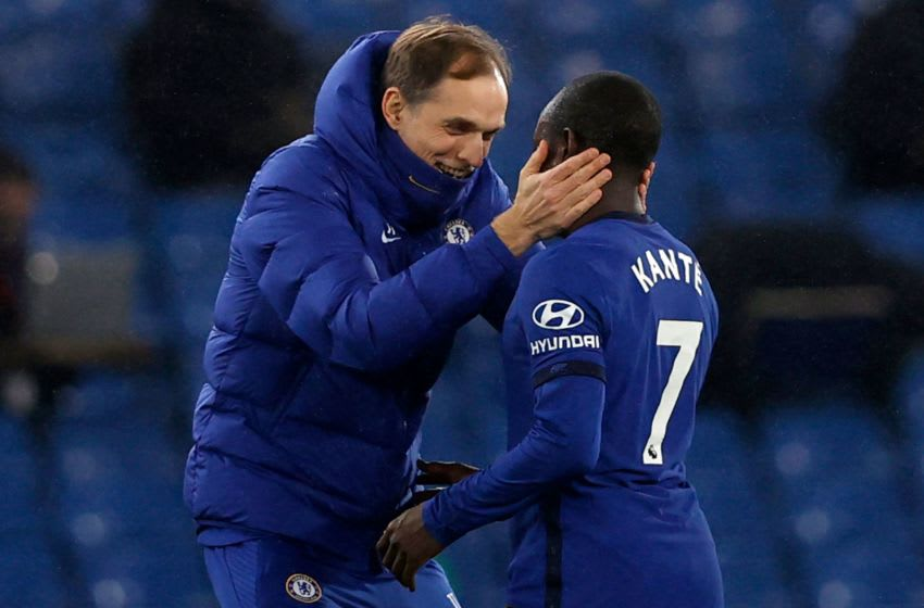 Chelsea's German head coach Thomas Tuchel (L) embraces Chelsea's French midfielder N'Golo Kante after the English Premier League football match between Chelsea and Newcastle United at Stamford Bridge in London on February 15, 2021. (Photo by Adrian DENNIS / POOL / AFP) / RESTRICTED TO EDITORIAL USE. No use with unauthorized audio, video, data, fixture lists, club/league logos or 'live' services. Online in-match use limited to 120 images. An additional 40 images may be used in extra time. No video emulation. Social media in-match use limited to 120 images. An additional 40 images may be used in extra time. No use in betting publications, games or single club/league/player publications. / (Photo by ADRIAN DENNIS/POOL/AFP via Getty Images)