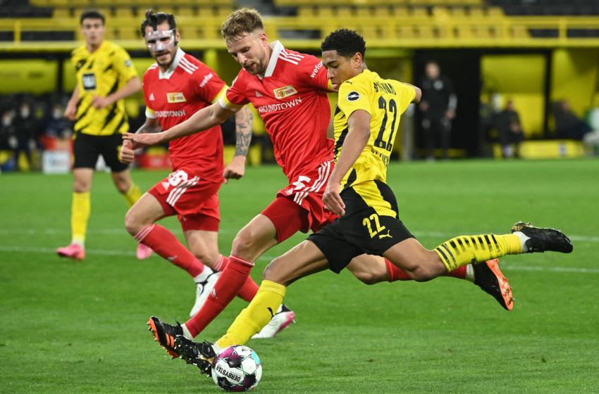 Dortmund's English midfielder Jude Bellingham (R) and Union Berlin's German defender Marvin Friedrich vie for the ball during the German first division Bundesliga football match Borussia Dortmund vs 1. FC Union, in Dortmund, western Germany, on April 21, 2021. - DFL REGULATIONS PROHIBIT ANY USE OF PHOTOGRAPHS AS IMAGE SEQUENCES AND/OR QUASI-VIDEO (Photo by Ina Fassbender / various sources / AFP) / DFL REGULATIONS PROHIBIT ANY USE OF PHOTOGRAPHS AS IMAGE SEQUENCES AND/OR QUASI-VIDEO (Photo by INA FASSBENDER/AFP via Getty Images)