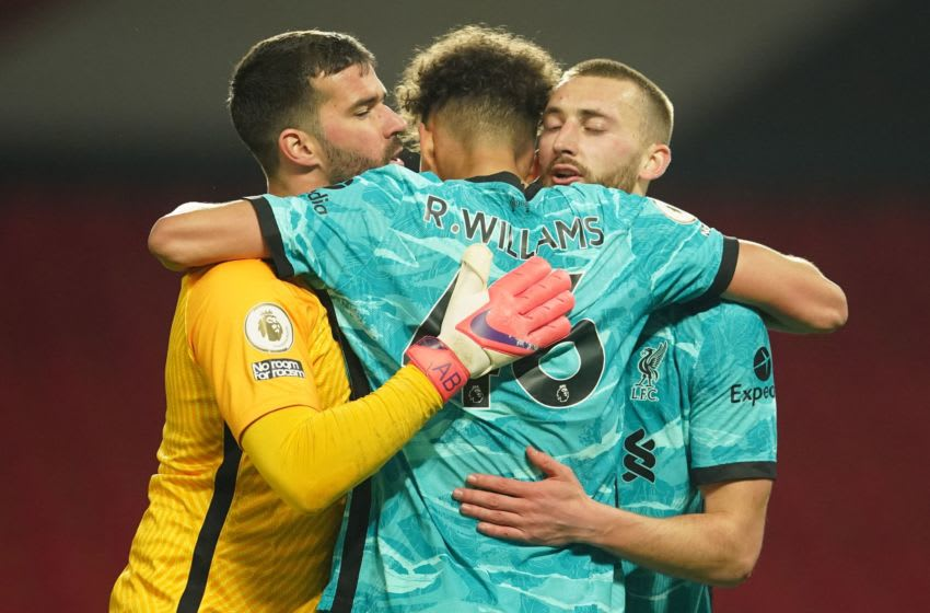 Liverpool's Alisson Becker, Rhys Williams, Nathaniel Phillips (Photo by DAVE THOMPSON/POOL/AFP via Getty Images)