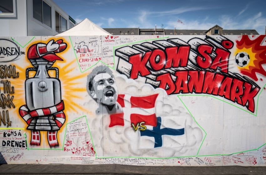 A mural with a portrait of Christian Eriksen and reads 'Come on, Denmark' (Photo by MADS CLAUS RASMUSSEN/Ritzau Scanpix/AFP via Getty Images)