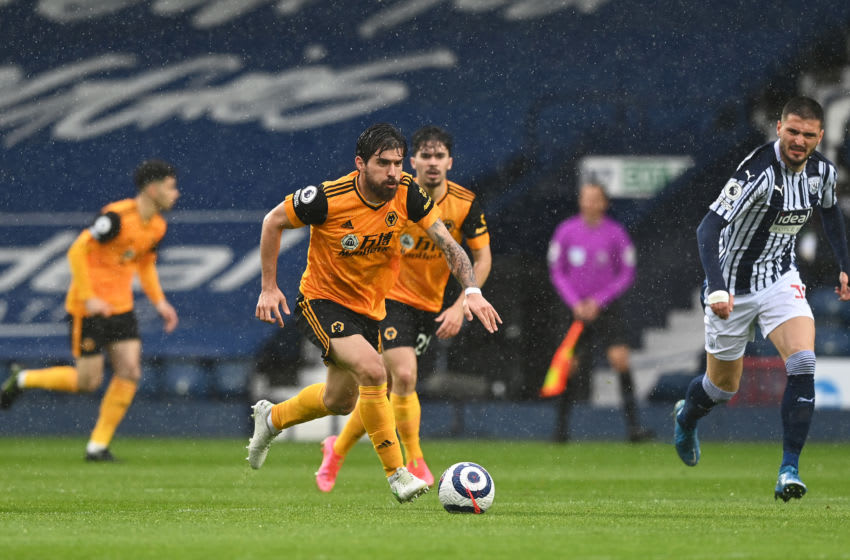 WEST BROMWICH, ENGLAND - MAY 03: Ruben Neves of Wolverhampton Wanderers runs with the ball during the Premier League match between West Bromwich Albion and Wolverhampton Wanderers at The Hawthorns on May 03, 2021 in West Bromwich, England. Sporting stadiums around the UK remain under strict restrictions due to the Coronavirus Pandemic as Government social distancing laws prohibit fans inside venues resulting in games being played behind closed doors. (Photo by Shaun Botterill/Getty Images)