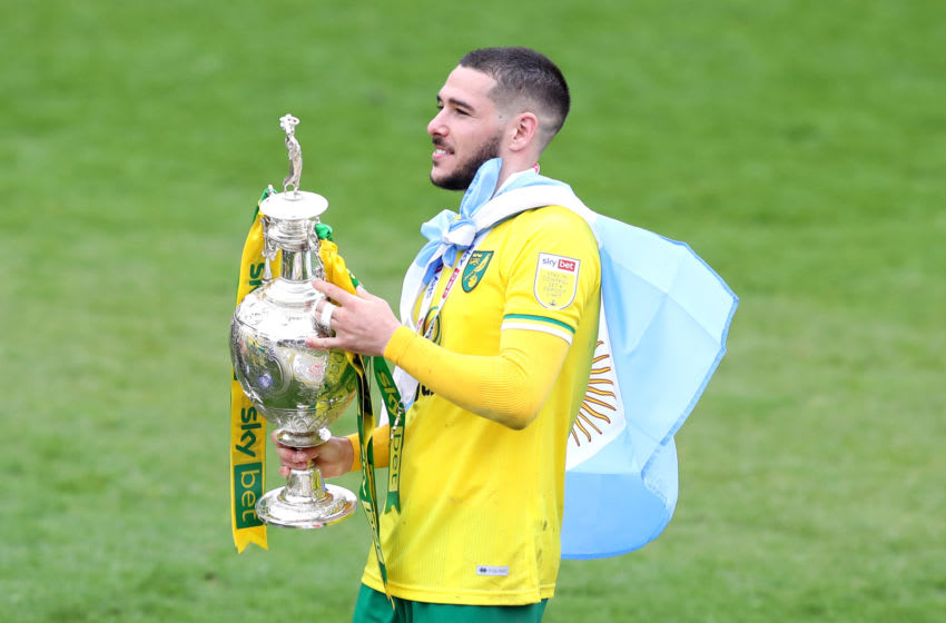 BARNSLEY, ENGLAND - MAY 08: Emiliano Buendia of Norwich City celebrates with the Sky Bet Championship trophy following the Sky Bet Championship match between Barnsley and Norwich City at Oakwell Stadium on May 08, 2021 in Barnsley, England. Sporting stadiums around the UK remain under strict restrictions due to the Coronavirus Pandemic as Government social distancing laws prohibit fans inside venues resulting in games being played behind closed doors. (Photo by George Wood/Getty Images)