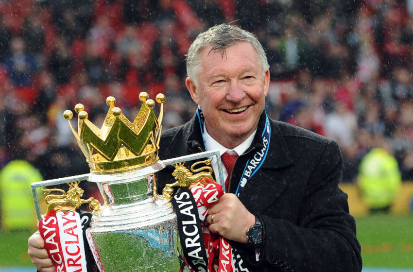 "CROPPED VERSION Manchester United's Scottish manager Alex Ferguson kisses the Premier League trophy at the end of the English Premier League football match between Manchester United and Swansea City at Old Trafford in Manchester, northwest England, on May 12, 2013. Ferguson said farewell to Old Trafford with a typically passionate speech after his side's 2-1 victory over Swansea in his final home match in charge of the team. AFP PHOTO / ANDREW YATES RESTRICTED TO EDITORIAL USE. No use with unauthorized audio, video, data, fixture lists, club/league logos or ""live"" services. Online in-match use limited to 45 images, no video emulation. No use in betting, games or single club/league/player publications (Photo credit should read ANDREW YATES/AFP via Getty Images)"