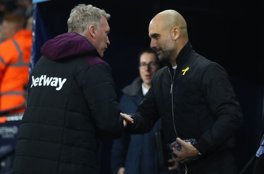 MANCHESTER, ENGLAND - DECEMBER 03: David Moyes, Manager of West Ham United and Josep Guardiola, Manager of Manchester City greet each other prior to the Premier League match between Manchester City and West Ham United at Etihad Stadium on December 3, 2017 in Manchester, England. (Photo by Clive Brunskill/Getty Images)