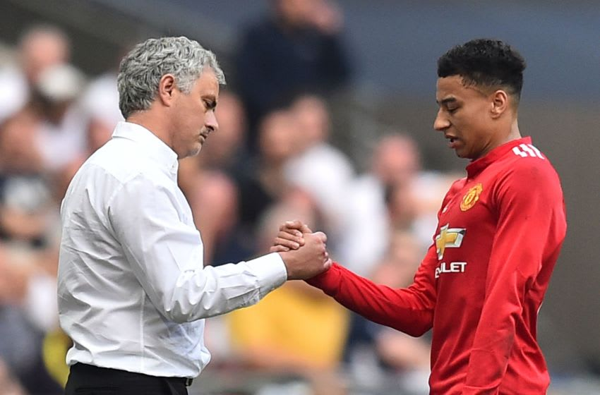Manchester United's Jose Mourinho and midfielder Jesse Lingard (Photo credit should read GLYN KIRK/AFP via Getty Images)