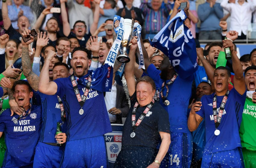 CARDIFF, WALES - MAY 06: Cardiff captain Sean Morrison (l) and manager Neil Warnock celebrate promotion to the premier league with the squad after the Sky Bet Championship match between Cardiff City and Reading at Cardiff City Stadium on May 6, 2018 in Cardiff, Wales. (Photo by Stu Forster/Getty Images)