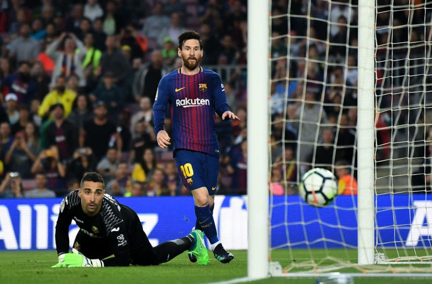 BARCELONA, SPAIN - MAY 09: Lionel Messi of FC Barcelona scores his team's third goal past Segio Asenjo of Villarreal CF during the La Liga match between Barcelona and Real Madrid at Camp Nou on May 9, 2018 in Barcelona, Spain. (Photo by David Ramos/Getty Images)