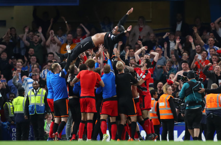 LONDON, ENGLAND - MAY 09: David Wagner, Manager of Huddersfield Town is throw into the air in celebration as his team avoid relegation after the Premier League match between Chelsea and Huddersfield Town at Stamford Bridge on May 9, 2018 in London, England. (Photo by Catherine Ivill/Getty Images)