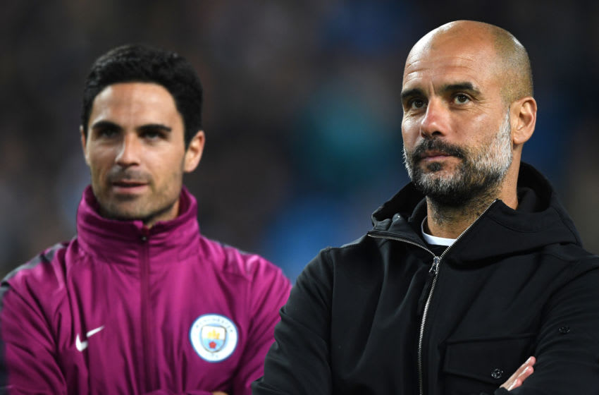 MANCHESTER, ENGLAND - MAY 09: Mikel Arteta and Josep Guardiola, Manager of Manchester City looks on during the Premier League match between Manchester City and Brighton and Hove Albion at Etihad Stadium on May 9, 2018 in Manchester, England. (Photo by Gareth Copley/Getty Images)
