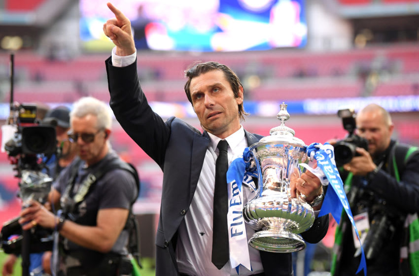 LONDON, ENGLAND - MAY 19: Antonio Conte, Manager of Chelsea celebrates with the Emirates FA Cup Trophy following his sides victory in The Emirates FA Cup Final between Chelsea and Manchester United at Wembley Stadium on May 19, 2018 in London, England. (Photo by Laurence Griffiths/Getty Images)