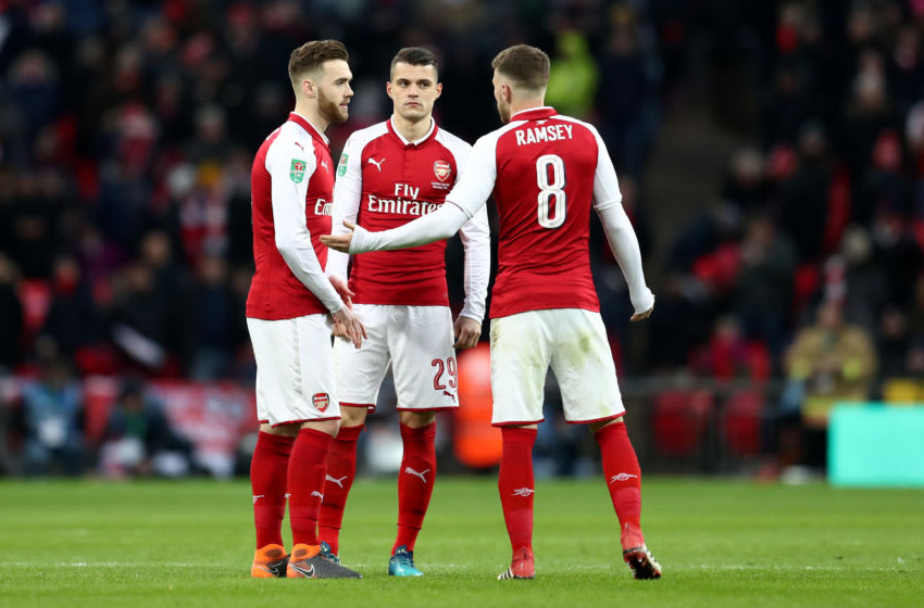 LONDON, ENGLAND - FEBRUARY 25: Aaron Ramsey of Arsenal talks to Calum Chambers and Granit Xhaka of Arsenal during the Carabao Cup Final between Arsenal and Manchester City at Wembley Stadium on February 25, 2018 in London, England. (Photo by Catherine Ivill/Getty Images)