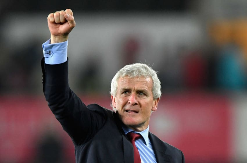 SWANSEA, WALES - MAY 08: Mark Hughes, Manager of Southampton celebrates during the Premier League match between Swansea City and Southampton at Liberty Stadium on May 8, 2018 in Swansea, Wales. (Photo by Stu Forster/Getty Images)