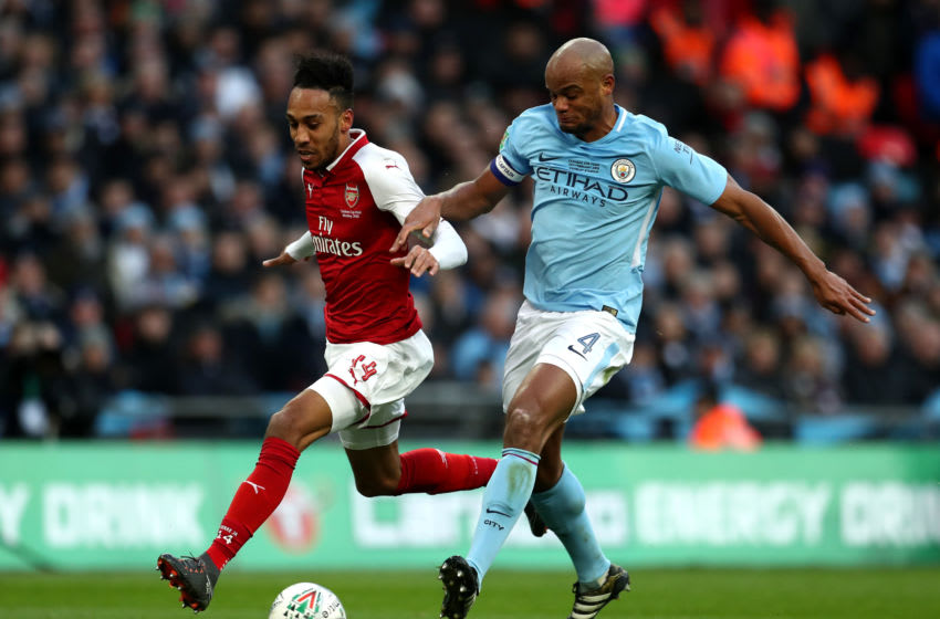 LONDON, ENGLAND - FEBRUARY 25: Pierre-Emerick Aubameyang of Arsenal and Vincent Kompany of Manchester City compete for the ball during the Carabao Cup Final between Arsenal and Manchester City at Wembley Stadium on February 25, 2018 in London, England. (Photo by Catherine Ivill/Getty Images)