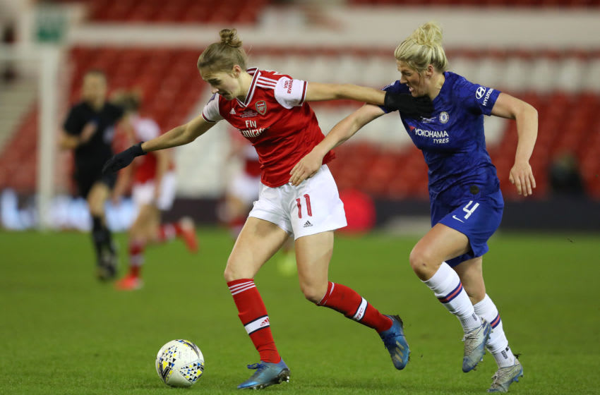Vivianne Miedema of Arsenal with Millie Bright of Chelsea (Photo by Catherine Ivill/Getty Images)