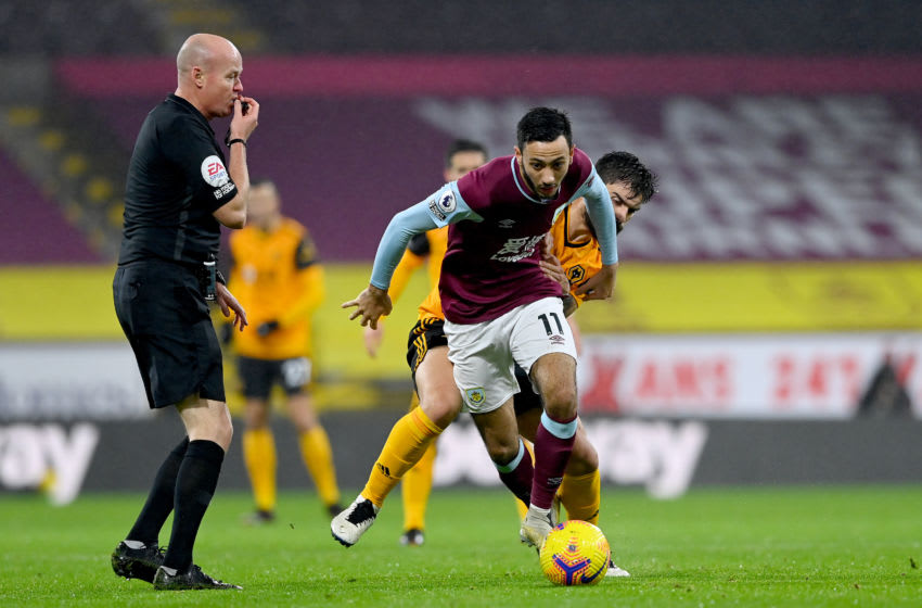 Dwight McNeil of Burnley and Ruben Neves of Wolverhampton Wanderers (Photo by Sam Bagnall - AMA/Getty Images)