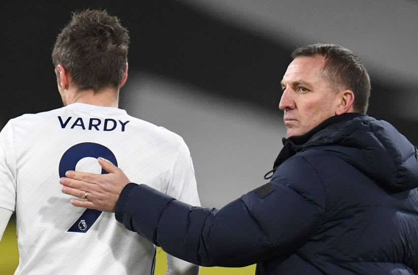 Leicester City's manager Brendan Rodgers and striker Jamie Vardy (Photo by PETER POWELL/POOL/AFP via Getty Images)
