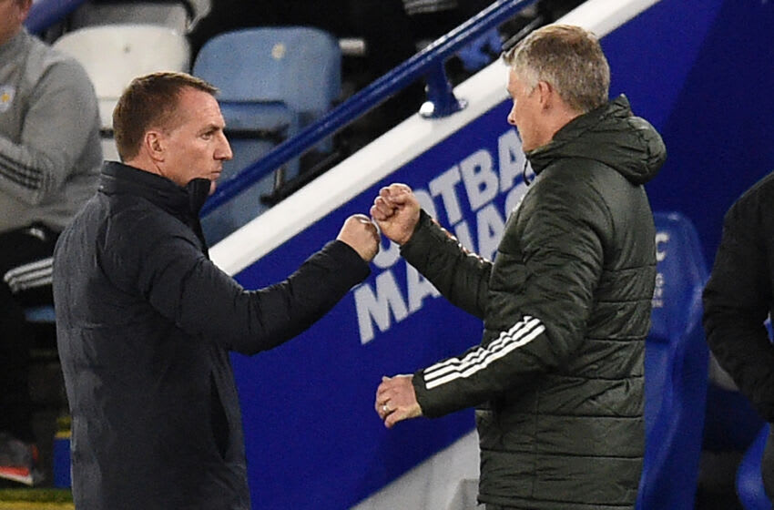 Leicester City's manager Brendan Rodgers and Manchester United's manager Ole Gunnar Solskjaer (Photo by OLI SCARFF/POOL/AFP via Getty Images)