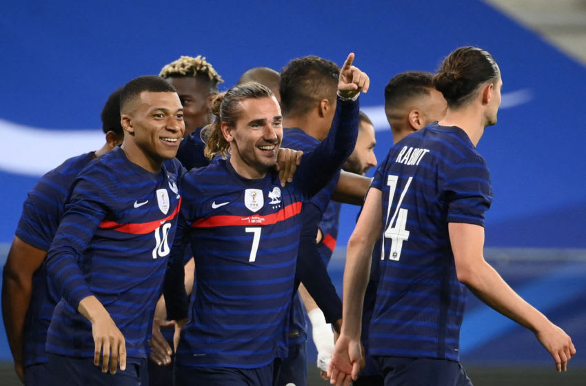 France's forward Antoine Griezmann (C) celebrates with France's forward Kylian Mbappe after scoring his team's second goal during the friendly football match between France and Wales at the Allianz Riviera Stadium in Nice, southern France on June 2, 2021 as part of the team's preparation for the upcoming 2020-2021 Euro football tournament. (Photo by FRANCK FIFE / AFP) (Photo by FRANCK FIFE/AFP via Getty Images)
