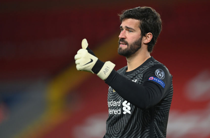 LIVERPOOL, ENGLAND - OCTOBER 27: Alisson Becker of Liverpool in action during the UEFA Champions League Group D stage match between Liverpool FC and FC Midtjylland at Anfield on October 27, 2020 in Liverpool, England. Sporting stadiums around the UK remain under strict restrictions due to the Coronavirus Pandemic as Government social distancing laws prohibit fans inside venues resulting in games being played behind closed doors. (Photo by Michael Regan/Getty Images)