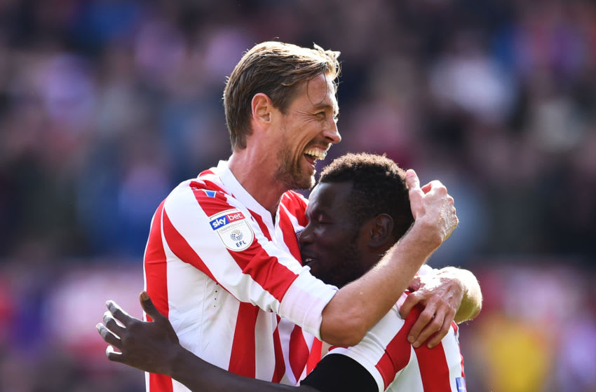 STOKE ON TRENT, ENGLAND - AUGUST 25: Mame Biram Diouf of Stoke his hugged by Peter Crouch after an own goal by Jordy de Wijs of Hull during the Sky Bet Championship match between Stoke City and Hull City at Bet365 Stadium on August 25, 2018 in Stoke on Trent, England. (Photo by Nathan Stirk/Getty Images)