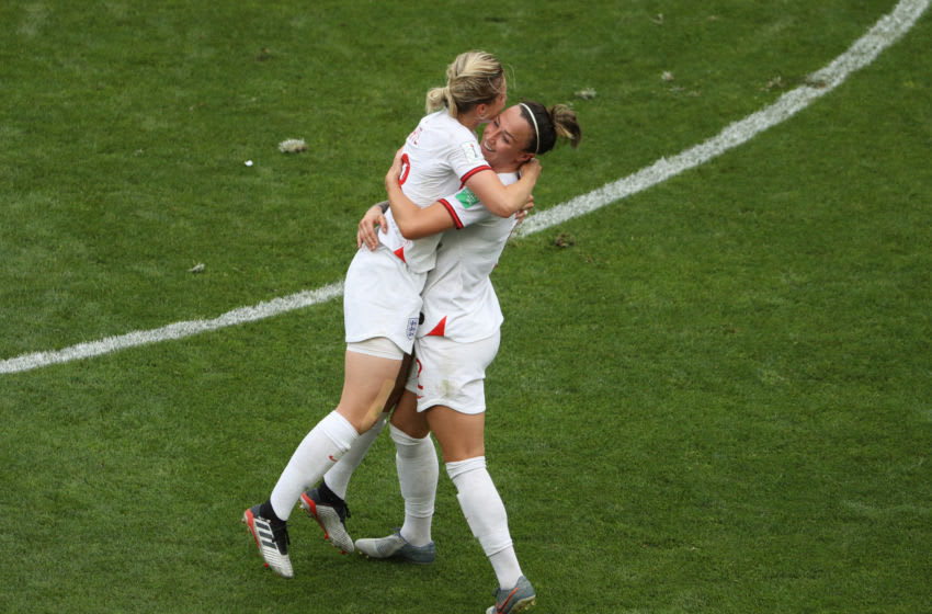 VALENCIENNES, FRANCE - JUNE 23: Ellen White of England celebrates with teammate Lucy Bronze after scoring her team's second goal during the 2019 FIFA Women's World Cup France Round Of 16 match between England and Cameroon at Stade du Hainaut on June 23, 2019 in Valenciennes, France. (Photo by Robert Cianflone/Getty Images)