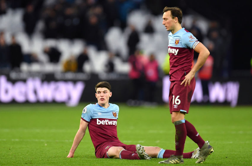 LONDON, ENGLAND - FEBRUARY 01: Declan Rice of West Ham United and Mark Noble of West Ham United looks dejected after the Premier League match between West Ham United and Brighton & Hove Albion at London Stadium on February 01, 2020 in London, United Kingdom. (Photo by Justin Setterfield/Getty Images)