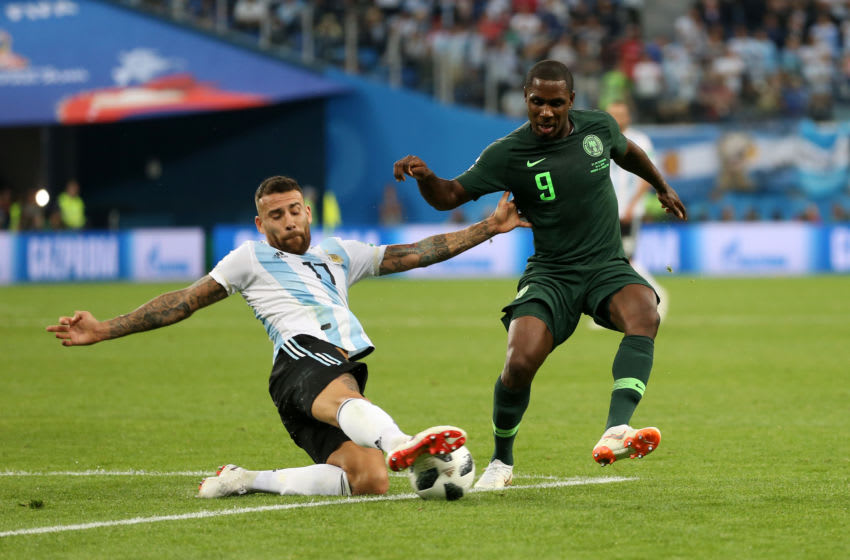 SAINT PETERSBURG, RUSSIA - JUNE 26: Nicolas Otamendi of Argentina slides in to tackle Odion Ighalo of Nigeria during the 2018 FIFA World Cup Russia group D match between Nigeria and Argentina at Saint Petersburg Stadium on June 26, 2018 in Saint Petersburg, Russia. (Photo by Gabriel Rossi/Getty Images)
