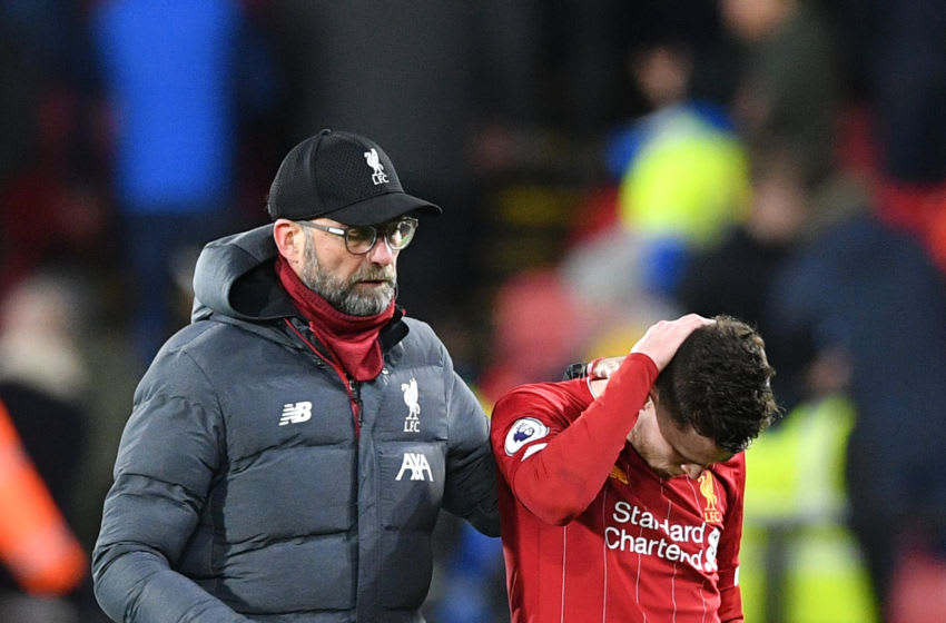 Liverpool's German manager Jurgen Klopp (L) and Liverpool's Scottish defender Andrew Robertson react at the final whistle during the English Premier League football match between Watford and Liverpool at Vicarage Road Stadium in Watford, north of London on February 29, 2020. (Photo by Justin TALLIS / AFP) / RESTRICTED TO EDITORIAL USE. No use with unauthorized audio, video, data, fixture lists, club/league logos or 'live' services. Online in-match use limited to 120 images. An additional 40 images may be used in extra time. No video emulation. Social media in-match use limited to 120 images. An additional 40 images may be used in extra time. No use in betting publications, games or single club/league/player publications. / (Photo by JUSTIN TALLIS/AFP via Getty Images)