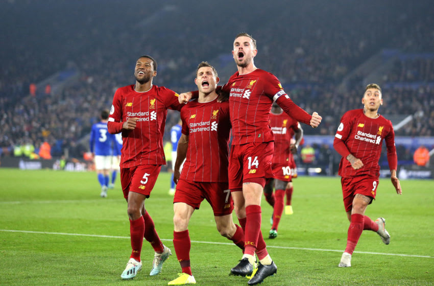 LEICESTER, ENGLAND - DECEMBER 26: James Milner of Liverpool celebrates after scoring his sides second goal with Jordan Henderson and Georginio Wijnaldum during the Premier League match between Leicester City and Liverpool FC at The King Power Stadium on December 26, 2019 in Leicester, United Kingdom. (Photo by Alex Pantling/Getty Images)