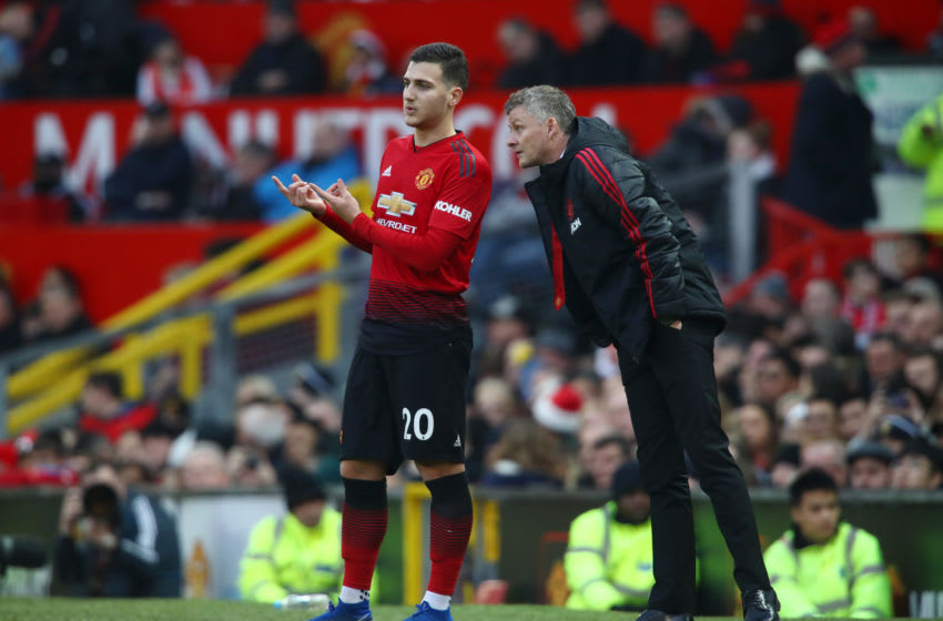 Ole Gunnar Solskjae(R) and Diogo Dalot(L), Manchester United. (Photo by Clive Brunskill/Getty Images)