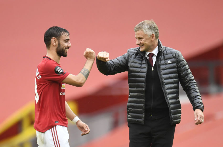 Bruno Fernandes(L) and Ole Gunnar Solskjae(R), Manchester United. (Photo by Peter Powell/Pool via Getty Images)