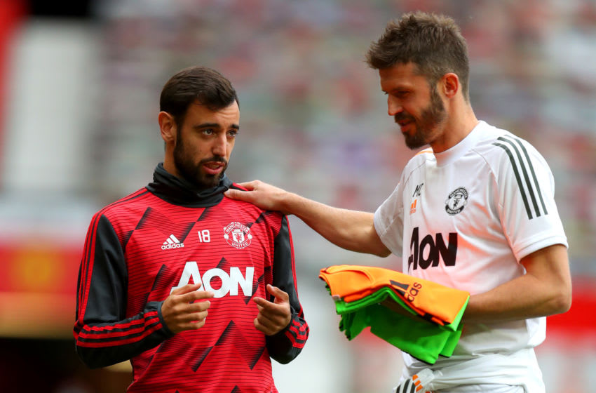 Bruno Fernandes(L) and Michael Carrick,(R), Manchester United. (Photo by Catherine Ivill/Getty Images)